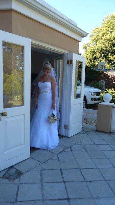 Bride on her way to the church in the Cottage bedroom doorway