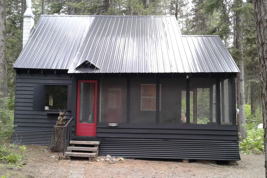 Our cozy cabin with screen porch is newly painted!