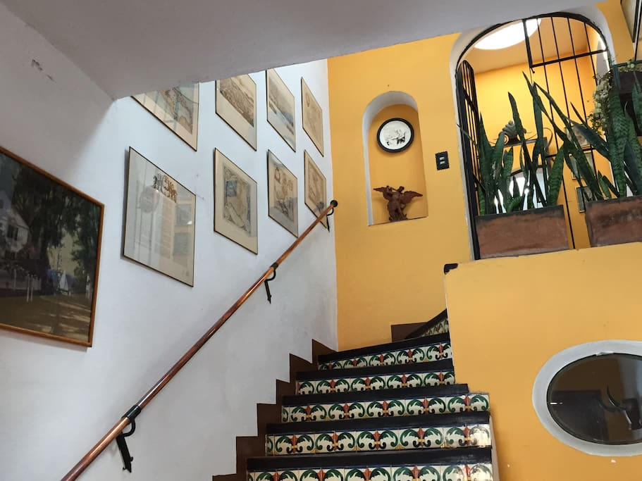 stairs leading to rooms and living and dining room