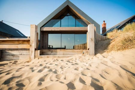 The Blue House on the Beach in Camber