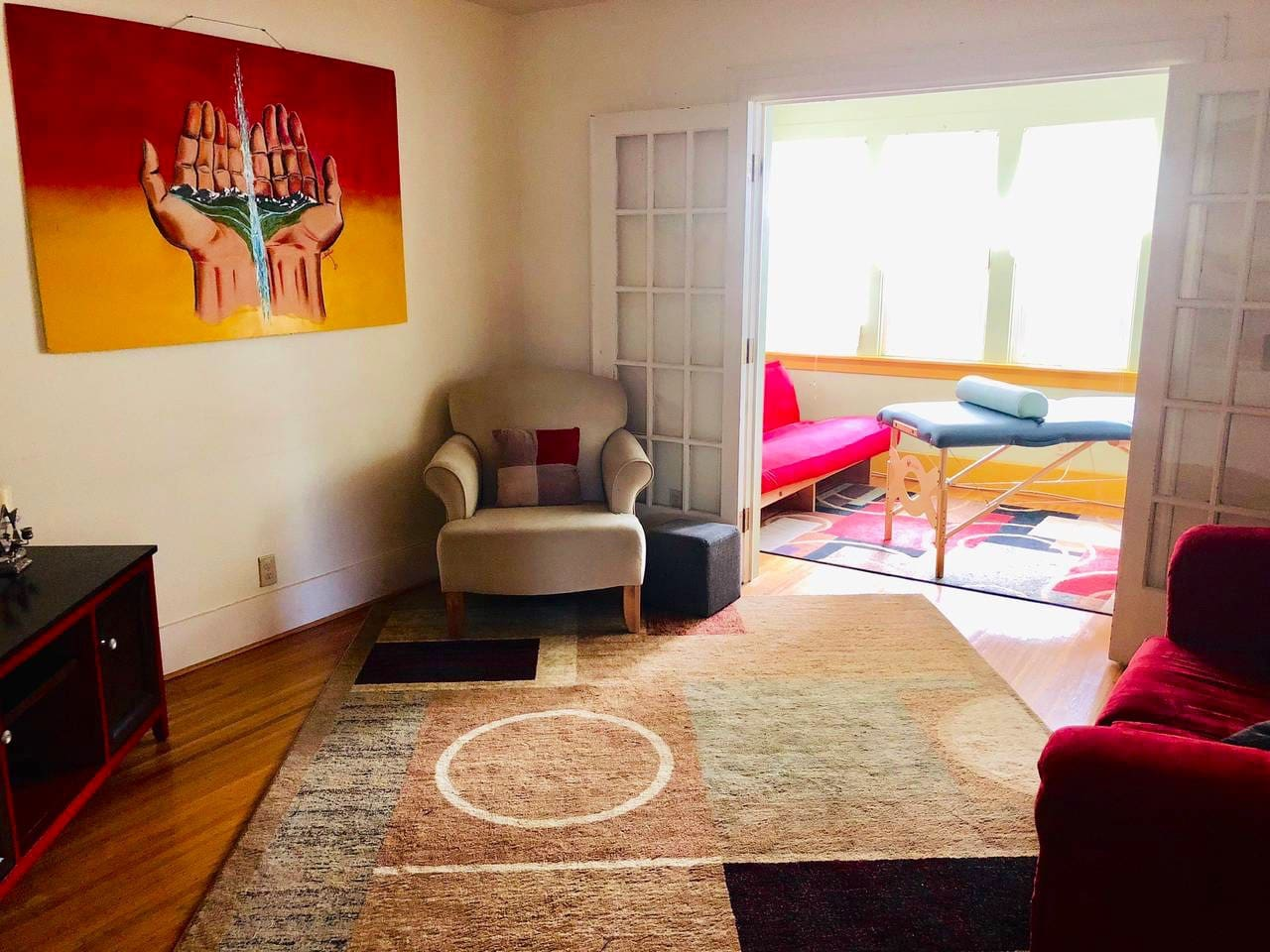 Living room with adjacent sunroom.