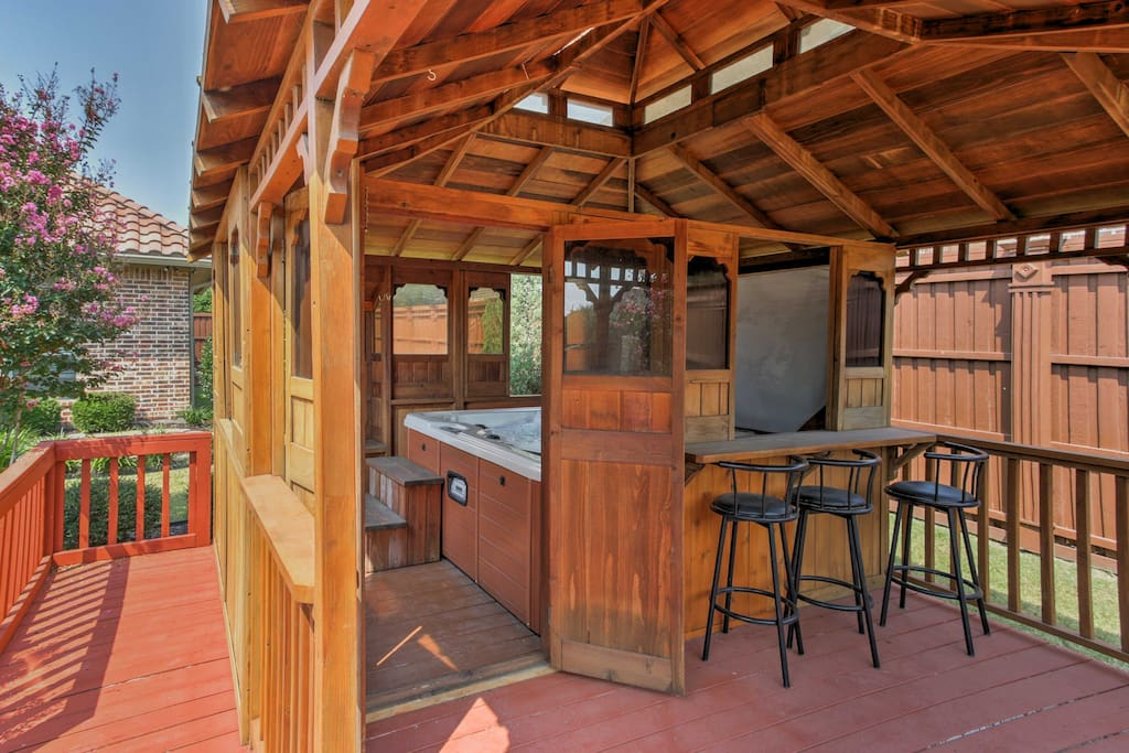 This spacious home features a covered patio and gazebo with a hot tub.