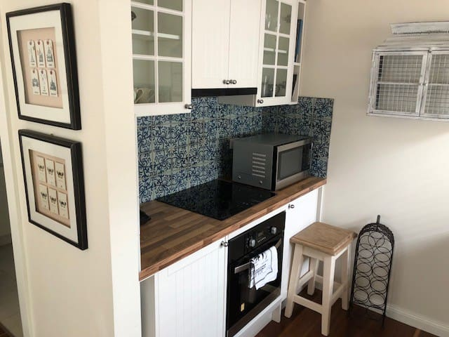Kitchen with stove, oven and convection microwave