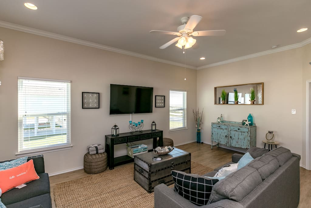 "Enjoy a movie night on the large 60"" flat screen TV in the living room"