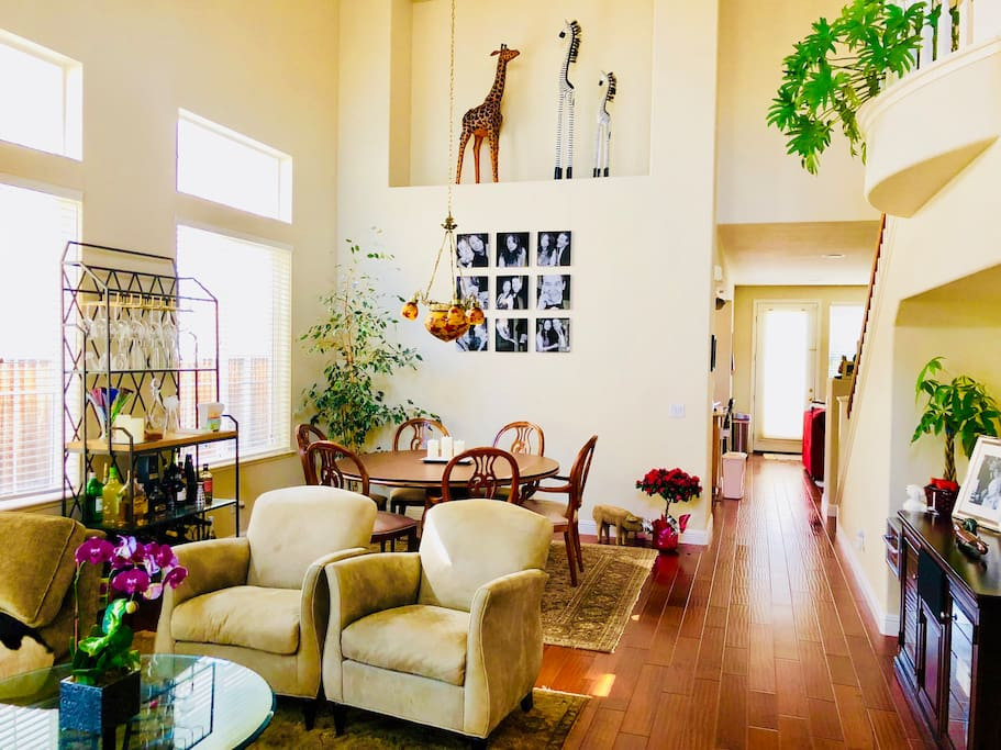Our beautiful high ceiling living room and formal dining room.