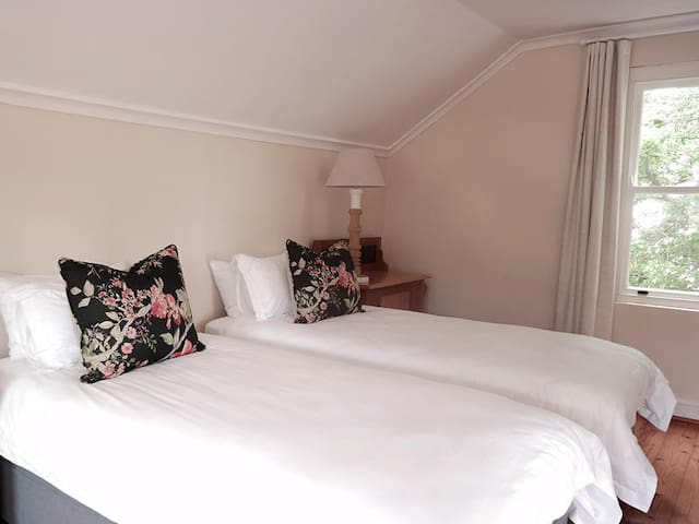 The Loft studio si spacious with views over the mountains.  The loft has an en-suite bathroom and a relaxing area.