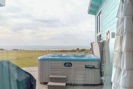 Dog-friendly, waterfront home w/ amazing views, private hot tub, & beach access
