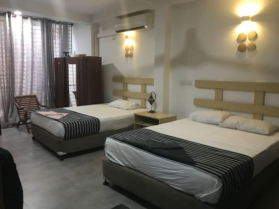 1st Floor bedroom, Spacious sleeps upto 2 couples or a family of 4, with ensuite, posture support mattress, sea views, sea breeze, king size beds, ceiling fan, air conditioning, linen and towels provided.