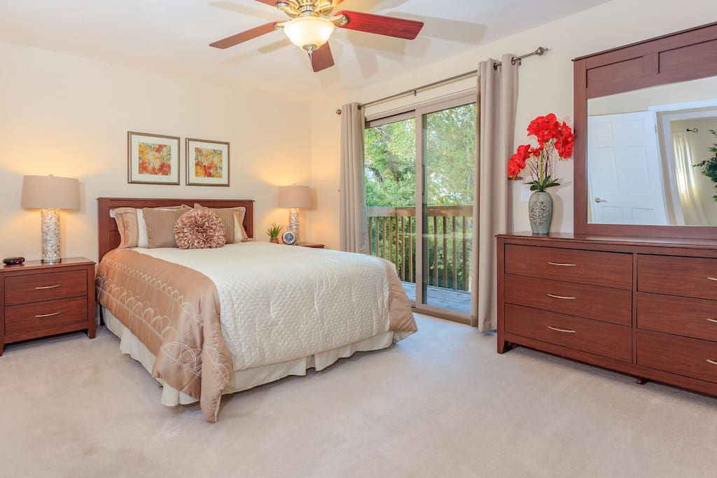 The master bedroom offers a queen-sized bed with 500+ thread-count sheets, generous walk-in closet, remodeled ensuite bathroom with dual showerheads and double sinks, and a balcony for enjoying the incredible vista.