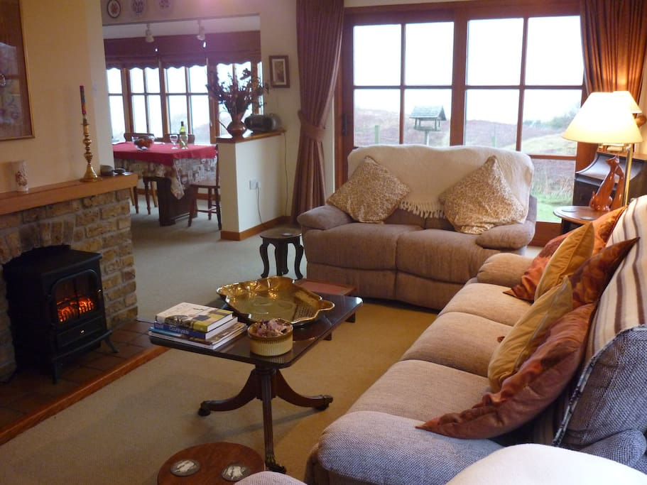 Sitting room, French windows to garden, dining room in bay window