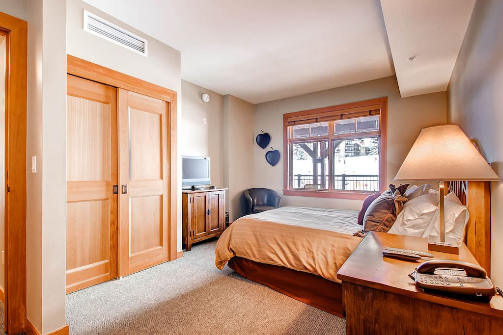 Master bedroom with King bed, flat screen TV