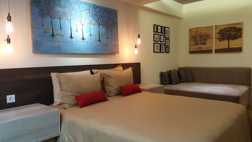 Spacious space with queen size bed and huge sofa that can be used as bed for extra person