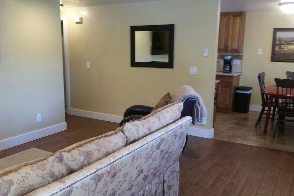 Spacious living room.  Opens up into kitchen.  Flat screen 4K Smart TV.  Unlimited Internet.
