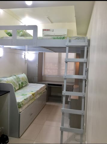 Top:  Loft bed (queen-size),  Below:  Daybed, Cabinets, Desk and TV area
