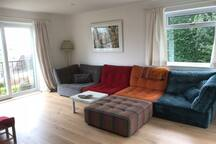 Newly Open planned living room dual aspect floor to ceiling sliding doors to gardens, front over looks the Levels