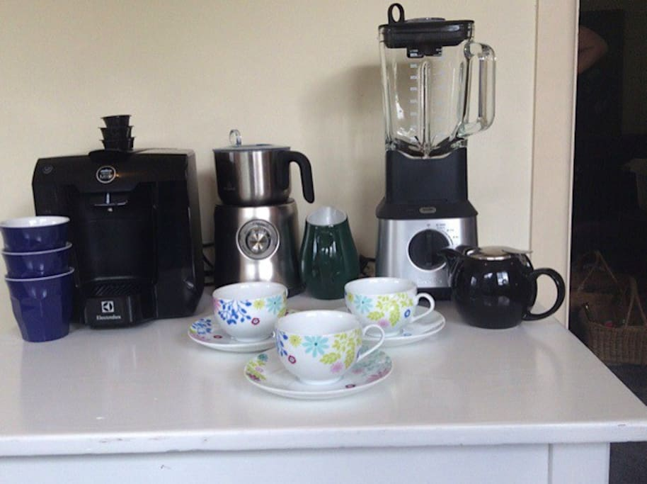 Fully appointed kitchen with Lavazza coffee pod machine, milk frother and blender