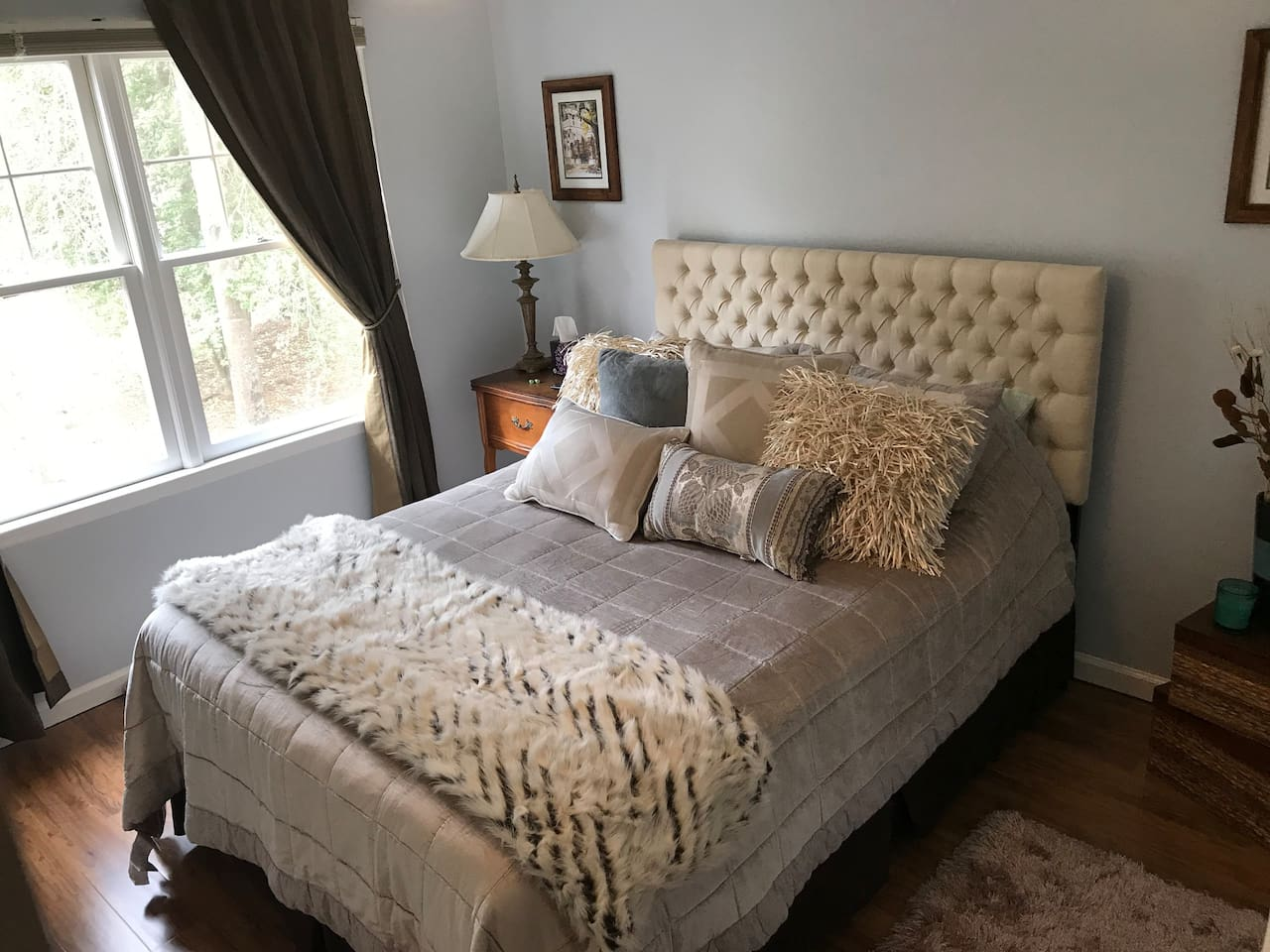 """Danielle's room with queen bed and 43""""  4K smart TV."""