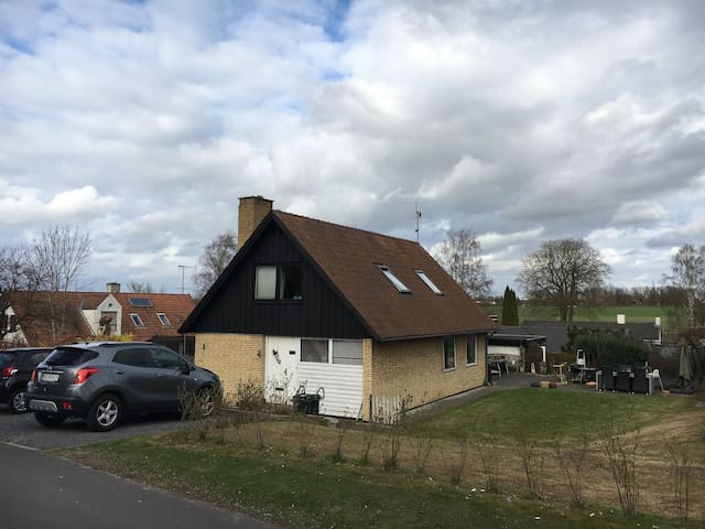 The house, viewed from the top of Kirkebakken, witch ends up in a patch. The area is very peaceful and friendly for kids