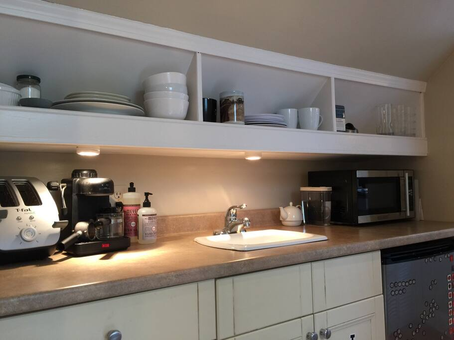A small kitchenette is perfect for making your own breakfast and snacks, with a mini-fridge, toaster and microwave.