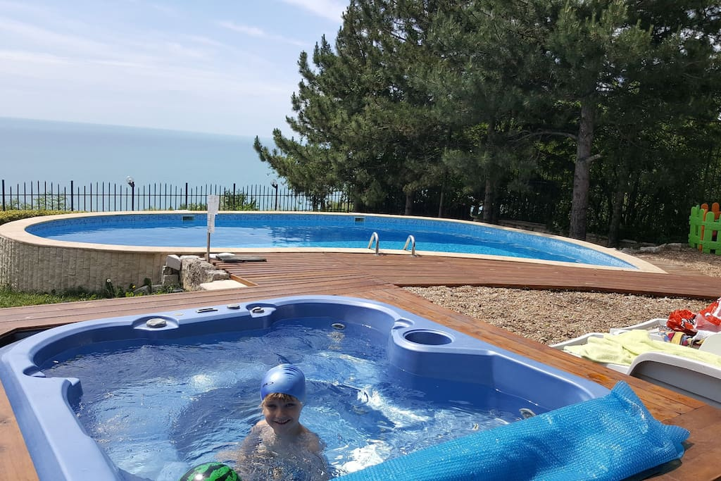 sea view from the jacuzzi and pool within the garden