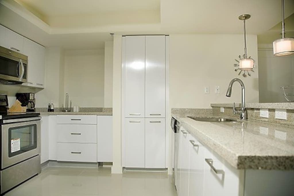 The kitchen is fully equipped, plenty of pots and pans, dishes and a full set of cooking utensils.