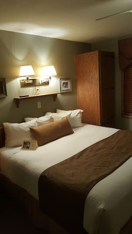 Very comfy king size bed with triple sheeted bedding - for a good night's rest!  Bedroom has two storage closets with space for hanging clothes and drawers
