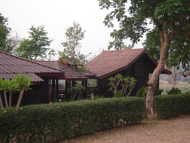 Lanna style homes with hot spring tubs in Pai