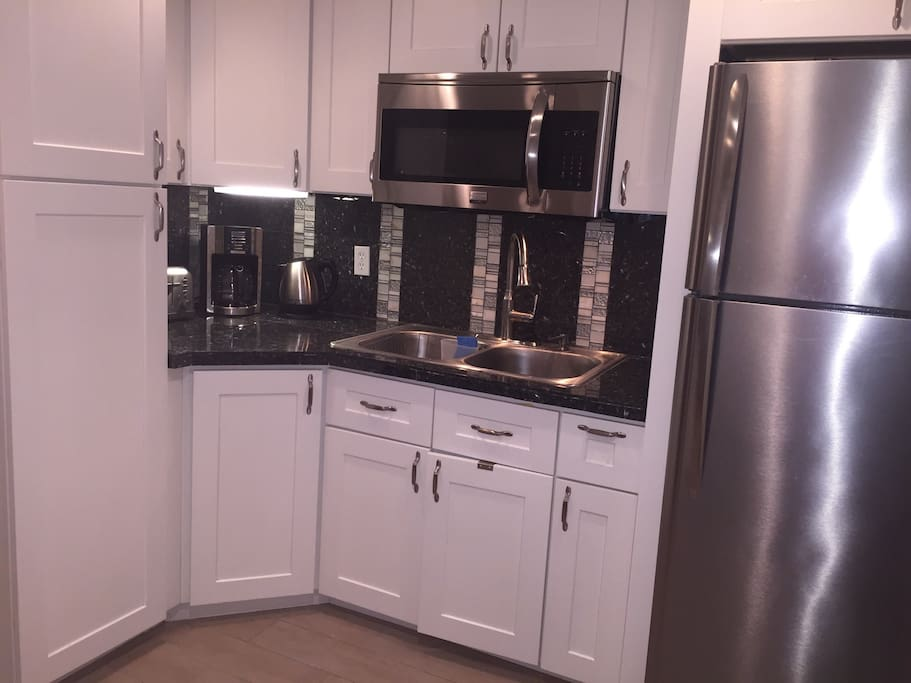 Kitchen: Kitchen includes microwave/ convection oven, refrigerator with ice maker and pantry.