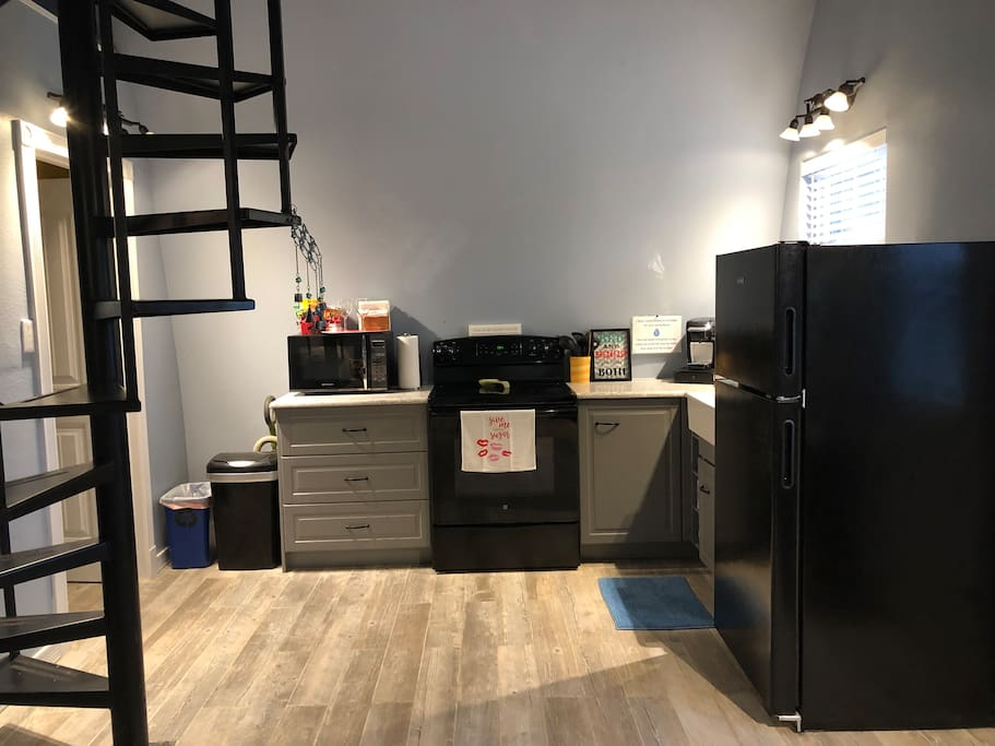 Full kitchen - stove, microwave, oven, refrigerator, and Keurig with coffee