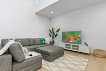 Comfortable lounge seating areas with large smart TV