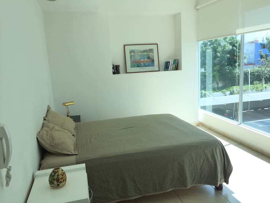 Quen size bed with panorama window.
