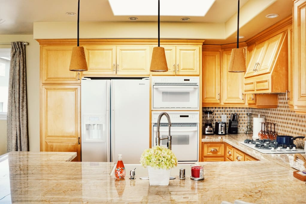 Open, bright kitchen with natural lighting. Feel free to cook - all appliances you might need are provided! (4-burner gas stove, refrigerator, microwave, oven, toaster, blender, coffee maker).
