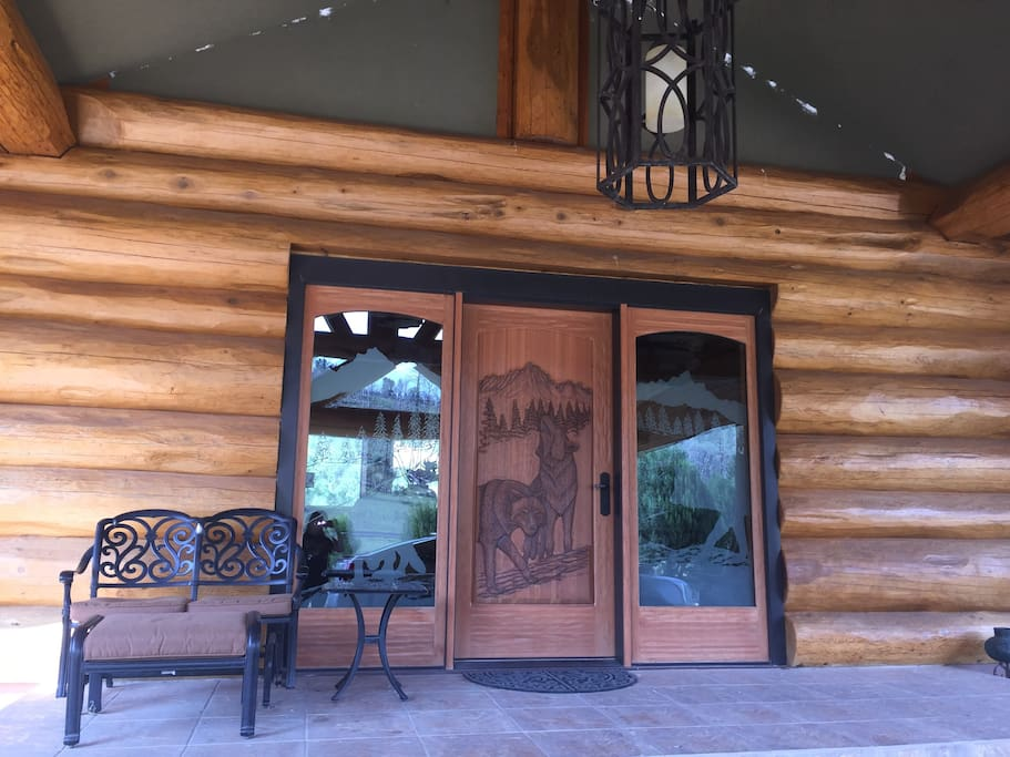 Front entry door with wolf carvings.Enter and feel the warmth of our home.