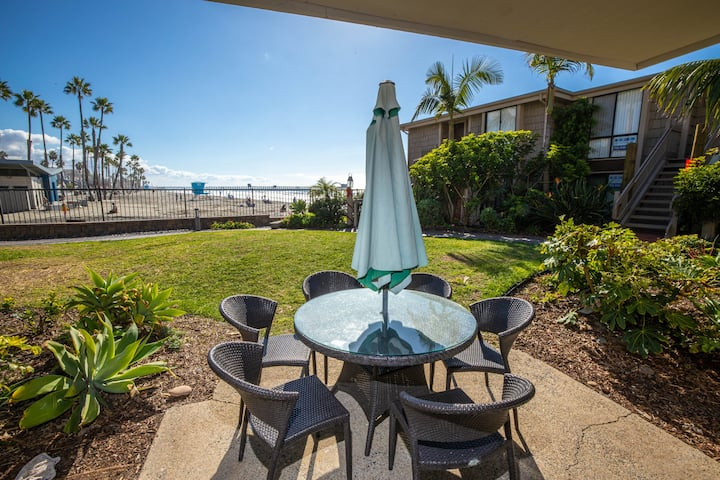 Amazing Beachfront Location! Your Own Patio & Grass Just Steps from the Sand!