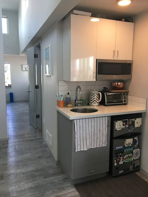 The sink is shared for both kitchen and bathroom. The fridge use is minimal as it is only a wee small fridge. There is no full kitchen, but enough appliances that we get by.