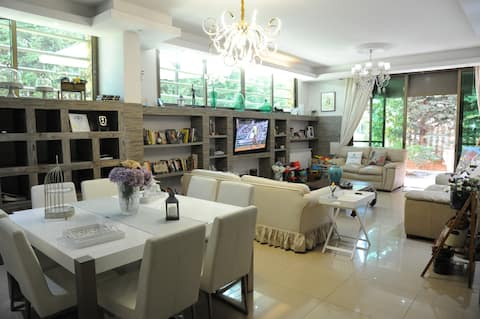 A modern & spacious 3-bed apartment with Patio