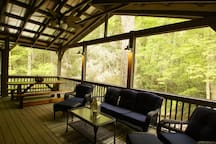 Private screened porch for eating, watching TV on a rainy day or just relax and listen to the bubbling creek.