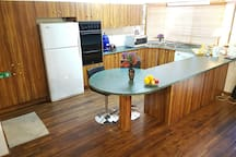 Spacious kitchen to cook with basic food, cooking and eating amenities available for you to use. Feel free to store your cold  and perishable food items in the fridge.