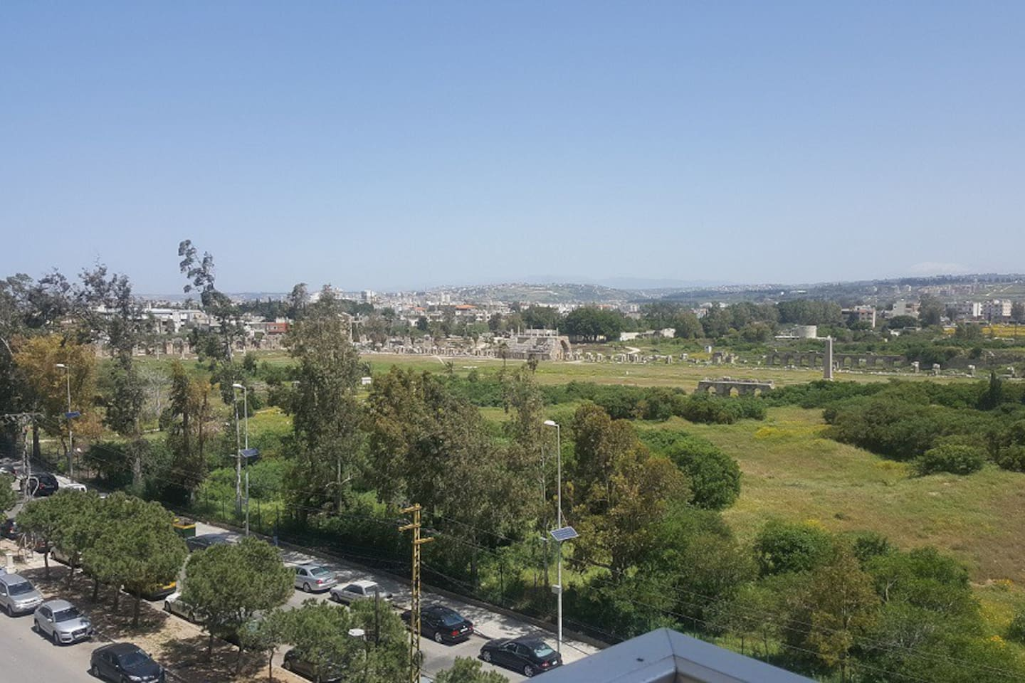 """View from balcony  : facing the  Tyre Hippodrome  """"The 480 meter long and 90 meter wide horseshoe shaped structure seated twenty thousand spectators who gathered to watch the death-defying sport of chariot racing. """""""