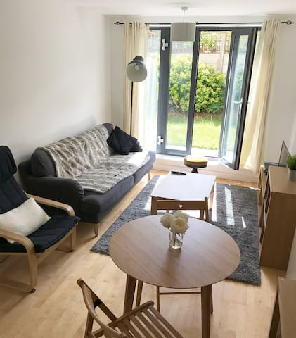 Lovely bright apartment with huge garden