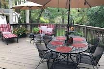 Shared deck area overlooking backyard and lake.