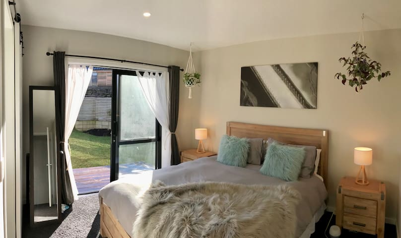 Master bedroom with ranch slider onto own small private deck.