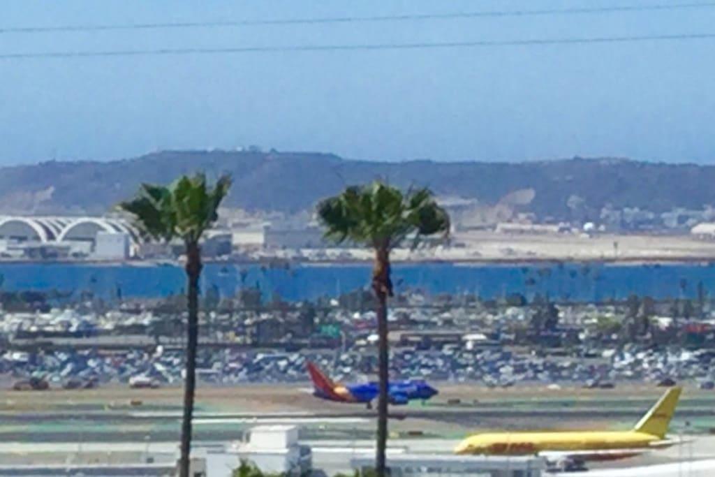 Stunning View from balcony of bay/harbor, airport, Coronado island and Point Loma.