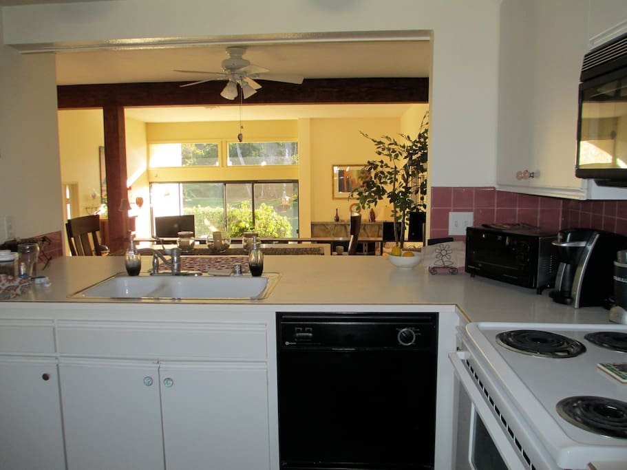 Large kitchen with toaster, coffee maker, dishwasher, microwave