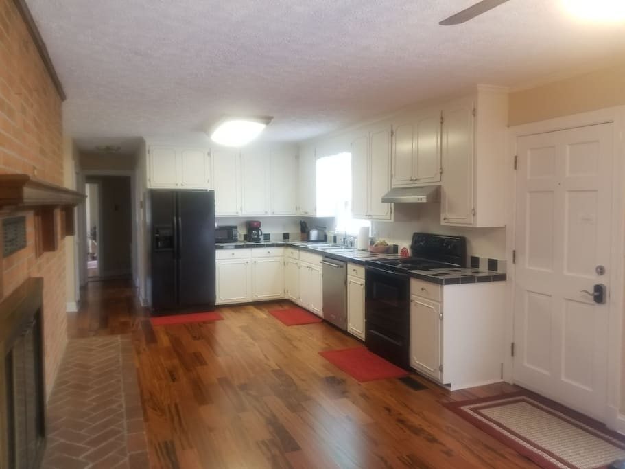 Kitchen equipped with stove, dishwasher, refrigerator, microwave, Keurig or Mr. Coffee, toaster, etc.
