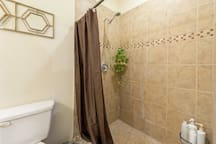 The shower is actually bigger than it appears here, and we provide shampoo, conditioner, and body wash.