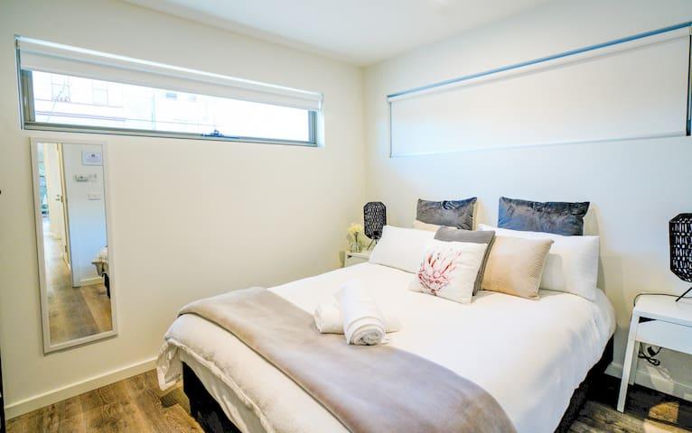 Bedroom- Queen bed with full size mirror