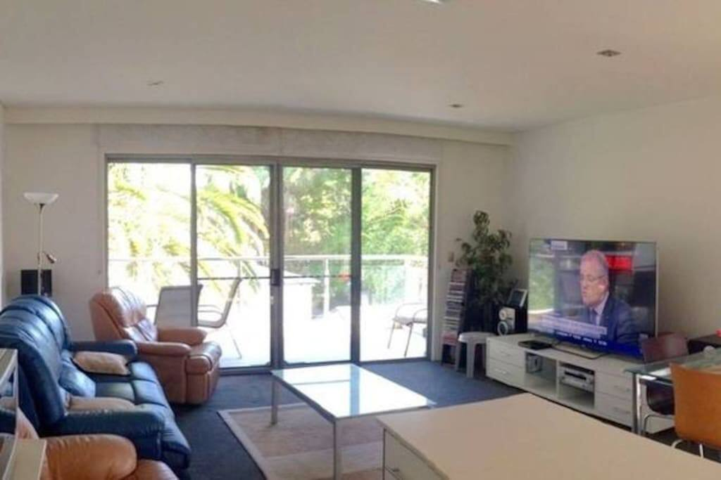"Lounge Area with huge Sony 75"" UHD 4K TV"