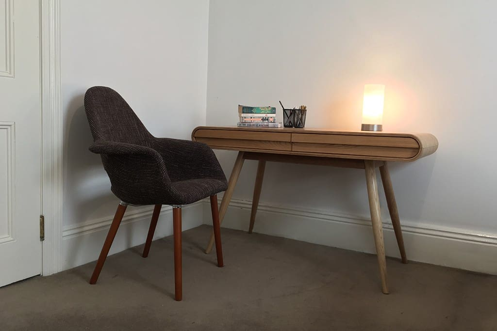Designer desk and chair for quiet study or work in your bedroom.