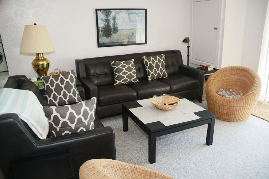 Living area upgraded recently with new leather couch and love seat.
